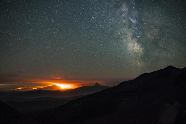 <p>Wildfires glow at night in Three Sisters Wilderness.</p>