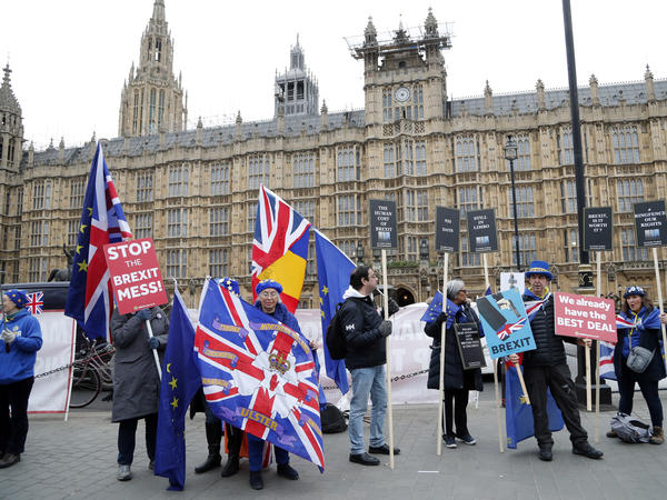 Demonstrators protest opposite the Houses of Parliament in London on Tuesday.