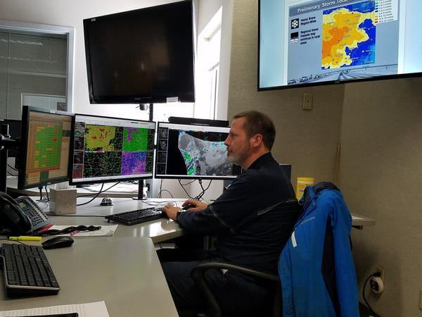 NWS Lincoln Lead Meteorologist Ed Shimon analyzes forecast information and satellite data at its Lincoln offices.