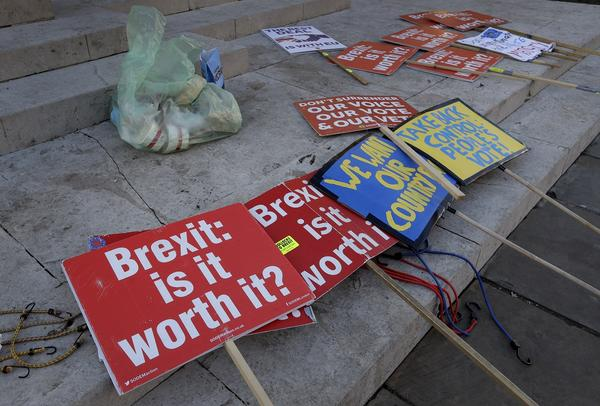 Brexit banners lie on the ground near parliament in London on Thursday, Jan. 17, 2019.