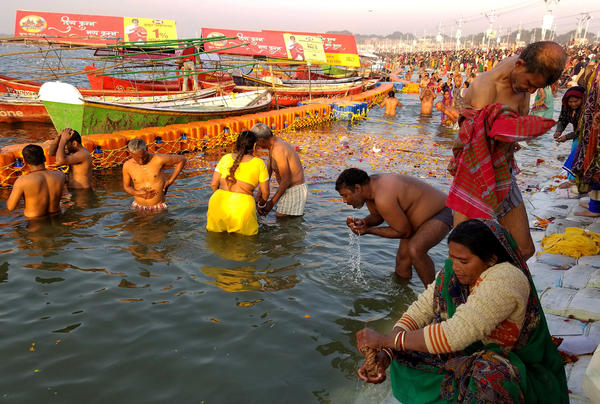 Pilgrims bathe at the confluence of the Ganges and Yamuna rivers in northern India as part of Kumbh Mela, a spiritual festival.