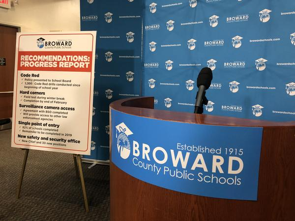 Broward County school district leaders display a board listing actions administrators have taken to enhance school safety since the Parkland shooting.