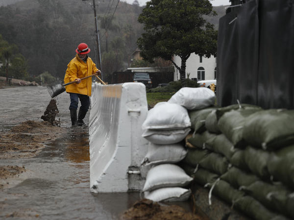 Lake Elsinore, Calif., was drenched Thursday by a storm that dropped rain and snow across much of the state. The National Weather Service is providing forecasts and warnings as usual, but employees are working without pay.