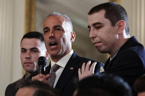 Andrew Pollack, father of slain Marjory Stoneman Douglas High School student Meadow Jade Pollack, joined by his sons, speaks during a listening session with President Donald Trump in February 2018.