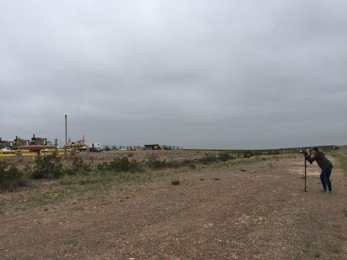 Sharon Wilson checking out an oil and gas facility near Balmorhea.