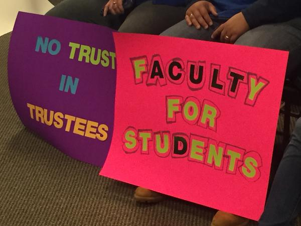 Wright State faculty union members protest at a 2018 Board of Trustees meeting.