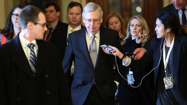 Senate Majority Leader Mitch McConnell, R-Ky., is trailed by reporters after speaking on the Senate floor on Tuesday.