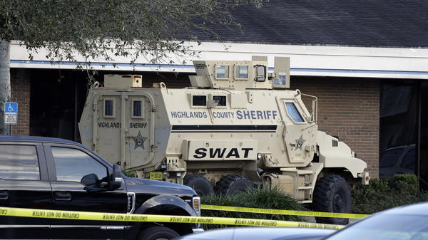 A Highlands County Sheriff's SWAT vehicle is stationed in front of a SunTrust Bank branch, Wednesday in Sebring, Fla., where authorities say five people were killed in a shooting.