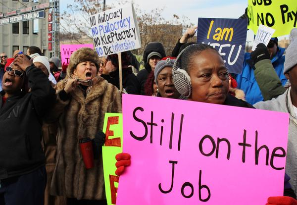 Hundreds of federal workers rallied against the government shutdown a few weeks ago in front of the IRS building near downtown. As the shutdown continues, many of those employees, along with an even larger number of contracted workers, remain without pay.