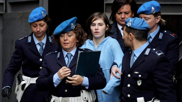 Police officers lead Amanda Knox from the Court of Appeal in Perugia, Italy, in November 2010.