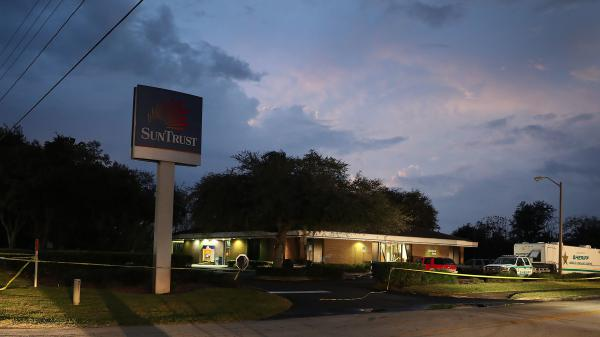 Five women were found lying facedown in the lobby of a SunTrust bank in Sebring, Fla., with gunshot wounds to their heads and backs, according to a police report.