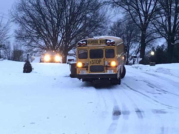 A school bus slid off slick roads in Tallmadge. Heavy snow, followed by rain and then cold temperatures made roads slick Thursday morning.