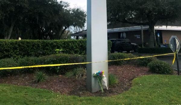 Flowers and police tape outside the Sebring SunTrust Bank