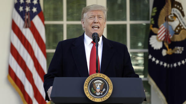President Trump speaks in the Rose Garden of the White House on Friday, saying he will endorse a short-term spending deal to end the government shutdown.