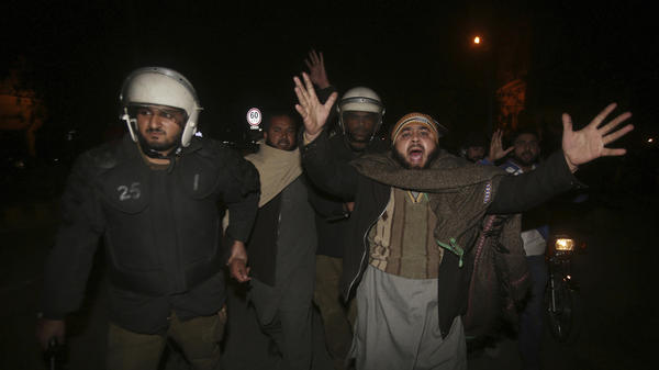 Police officers in Lahore, Pakistan, arrest a man protesting the Supreme Court's decision Tuesday regarding Asia Bibi, a Christian woman who was acquitted of blasphemy charges.