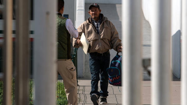 Carlos Catarlo Gomez, an asylum-seeker from Honduras, returns to Mexico from the United States while his case is processed. He was the first person returned under a new U.S. policy being called Remain in Mexico.