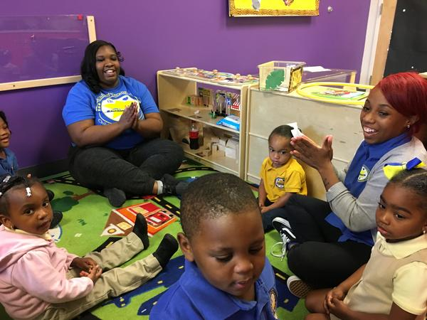 Teachers at Kids of Excellence in New Orleans start the morning off with songs in circle time. A state commission says there is a huge need for publically funded early childhood education.