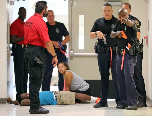 North Miami Police Department and Miami-Dade County Public Schools Police take part in an active shooter drill at North Miami Senior High on July 24, 2018. Researchers at the University of Florida are hoping to improve emergency preparation in schools.