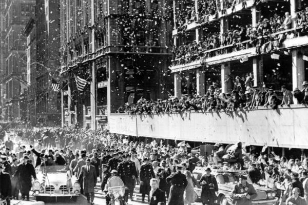 Glenn received a massive ticker-tape parade welcome along lower Broadway in New York on his way to a ceremony at City Hall on March 1, 1962.