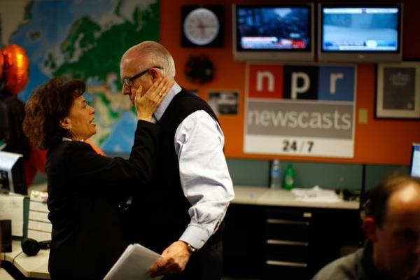 Newscaster Barbara Klein congratulates Kasell after his final news update.