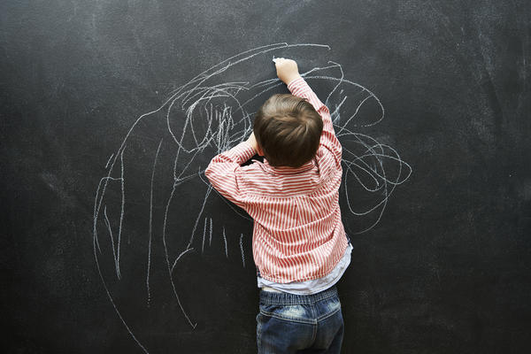 Lack of focus at school might be ADHD. Or it might be a function of being young for that grade.