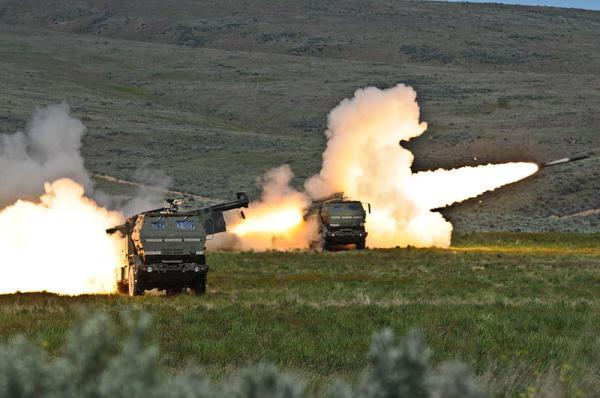Soldiers fire two rounds from their High Mobility Artillery Rocket systems at Yakima Training Center in 2011.