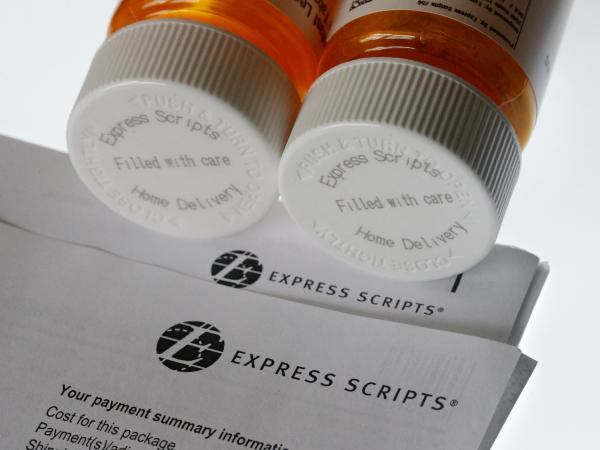 Health insurer Cigna is looking to increase its muscle by buying Express Scripts, a leading manager of prescription benefits.