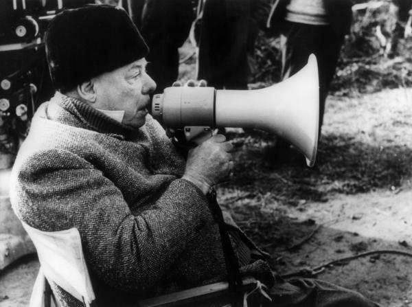 """Film director Jean Renoir grappled with his father's legacy. """"I have spent my life trying to determine the extent of the influence of my father upon me,"""" he wrote. Renoir is shown above filming his 1962 film, <em>The Elusive Corporal.</em>"""