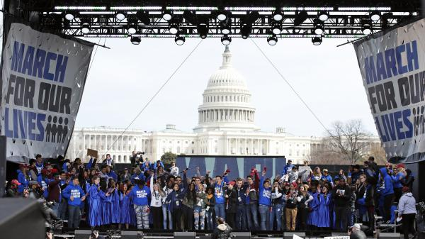 "Supporters fill the stage at the end of the ""March for Our Lives"" rally in support of gun control, on March 24, 2018, in Washington."