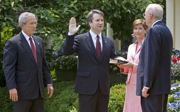 Brett Kavanaugh is sworn in as a federal judge by Supreme Court Justice Anthony Kennedy in 2006. President George W. Bush looks on. Kavanaugh is Trump's pick to replace Kennedy on the Supreme Court.