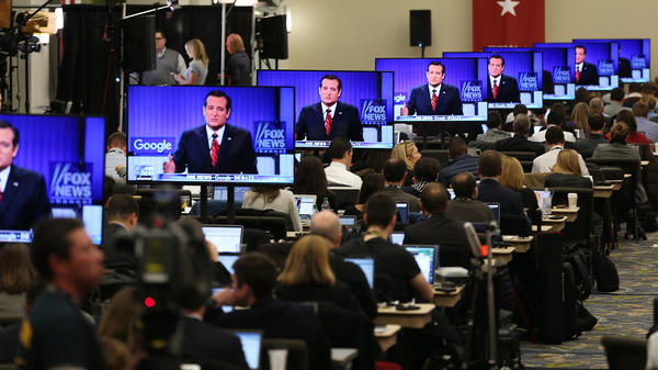 "Television screens are tuned to a Republican presidential debate sponsored by Fox News and Google in January 2016. ""People who get their news from Fox News actually take the strongest anti-immigrant position of any group we looked at in this survey,"" one pollster says."