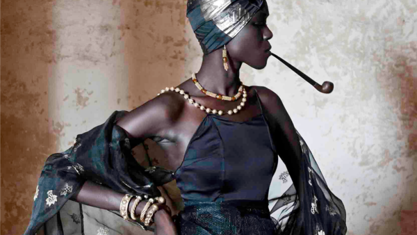 A Senegalese woman wears clothing and gold jewelry inspired by the fashions of the country's powerful <em>signares --</em> women who lived in the 18th and 19th century. The photo is featured in the exhibit at the Smithsonian's National Museum of African Art.