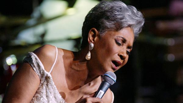 "Grammy-winning singer Nancy Wilson performs in 2003 at Lincoln Center's Avery Fisher Hall in New York during a concert titled ""Nancy Wilson With Strings: Celebrating Four Decades of Music."""