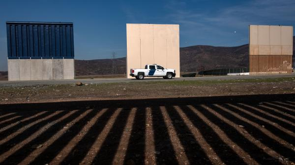 President Trump's wall prototypes are seen from behind the Mexico-US border fence in Tijuana, Mexico, on Dec. 12. With Congress unlikely to fund Trump's wall, Trump is floating other tactics.