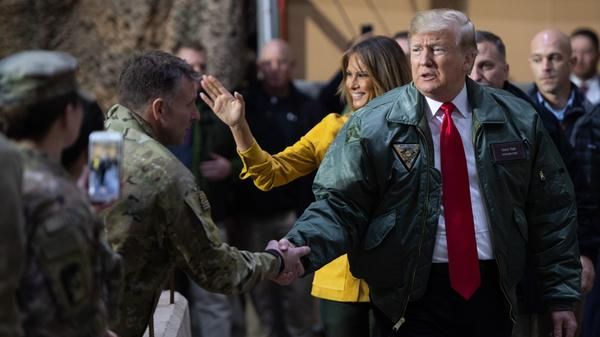 President Trump and first lady Melania Trump arrive to speak to members of the U.S. military during an unannounced trip to Al Asad Air Base in Iraq on Dec. 26.