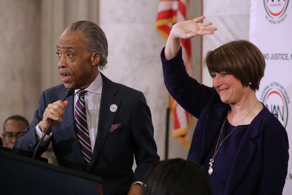 The Rev. Al Sharpton and Sen. Amy Klobuchar, D-Minn. at a November 2018 meeting of Sharpton's National Action Network on Capitol Hill. Klobuchar and other Democrats weighing a presidential bid have been courting the black community more intensively than past election cycles.