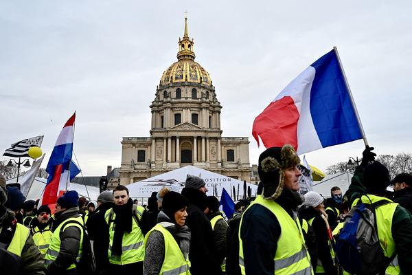 Protesters take part in an antigovernment yellow vest demonstration in front of the Hôtel National des Invalides in Paris early in January.