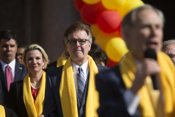 Lt. Gov. Dan Patrick looks on as Gov. Greg Abbott addresses the National School Choice Week rally in 2017.