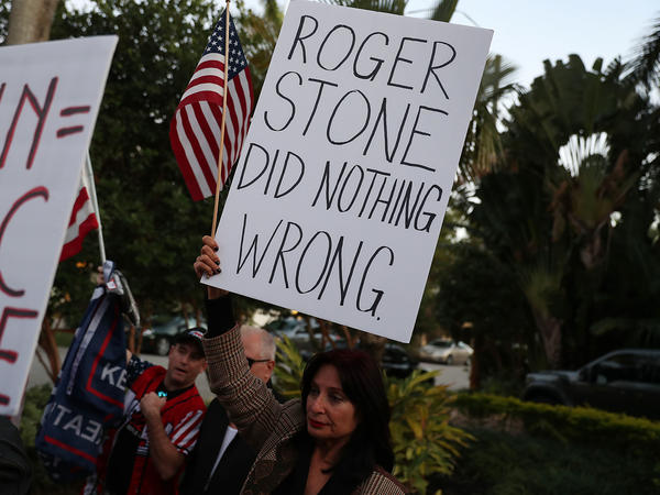Cindy Falco di Corrado joins with others to show their support for Roger Stone, a longtime adviser to President Trump. A number of Republicans have raised concerns about the way Stone was arrested at his home on Jan. 25.