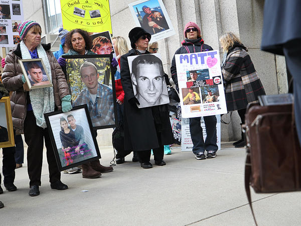Families that lost loved ones to the opioid crisis protested outside Suffolk Superior Court in Boston as lawyers for Purdue Pharma entered the courthouse for a status update in the Massachusetts attorney general's suit against the company on Jan. 25.