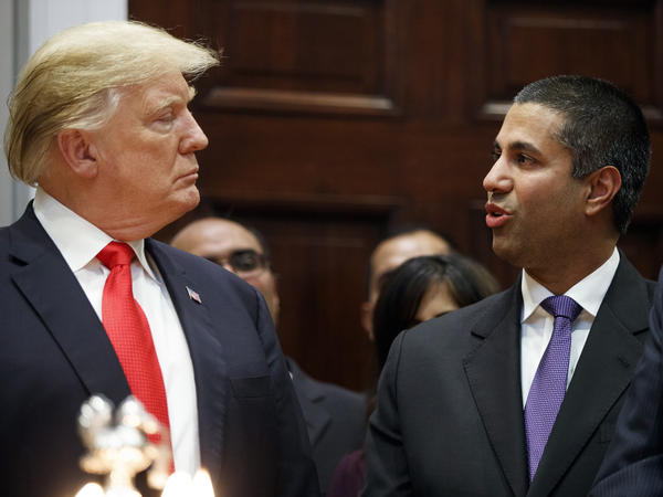 President Trump talks with FCC Chairman Ajit Pai at the White House in November. Under Pai, the FCC repealed Obama-era net neutrality rules. A federal court is reviewing that decision in oral arguments.