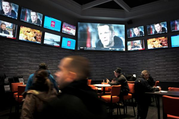 Patrons visit the sports betting area of Twin River Casino in Lincoln, R.I., on Monday. (Steven Senne/AP)