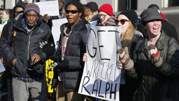 Demonstrators held signs and chanted outside the governor's office at the Capitol in Richmond, Va., over the weekend.
