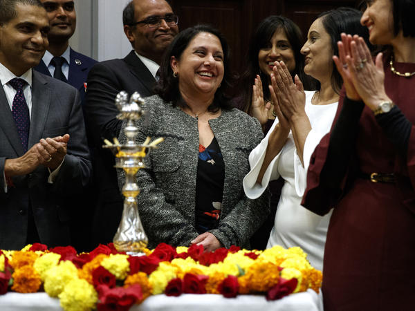 Neomi Rao, administrator of the Office of Information and Regulatory Affairs, smiled as President Trump announced her nomination to the D.C. Circuit Court of Appeals. Opponents want to block Rao.