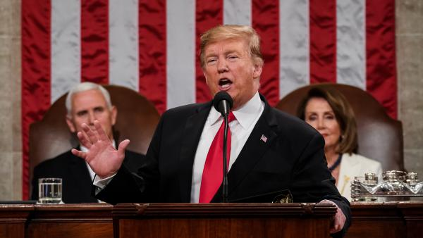 President Trump, with Speaker Nancy Pelosi, D-Calif., and Vice President Pence looking on, delivers the State of the Union address in the chamber of the U.S. House of Representatives Tuesday night.