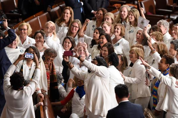 Congresswomen, dressed in white in tribute to the women's suffrage movement, pose for a photo as they arrive for the State of the Union address.