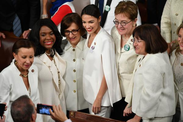 Rep. Alexandria Ocasio-Cortez, D-N.Y., poses for a picture with other women ahead of the State of the Union address.