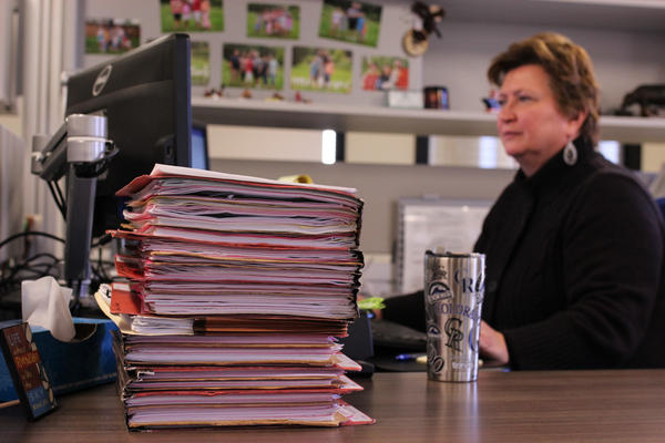Diane Pierson works through a stack of files at the Farm Service Agency office in Greeley, Colorado. She said she's thankful the shutdown didn't come during the spring when the office is its busiest.
