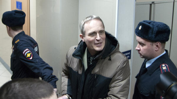 Dennis Christensen, a Danish Jehovah's Witness, is escorted from a court room in Orel, Russia, on Wednesday.