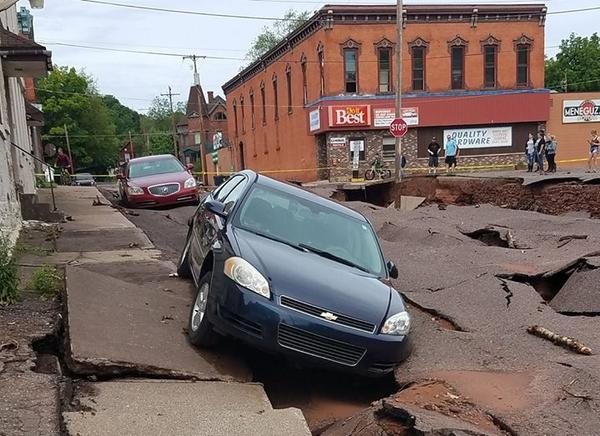A washed-out road in Lake Linden, Michigan shown just after extensive flooding in June 2018.